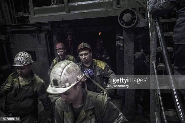 Coal miners exit the coal shaft elevator after working underground at the Pavlogradska coal preparation plant operated by DTEK Holdings BV in...