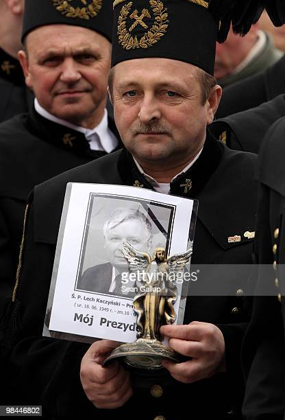 Coal miners from the southern Polish city of Katowice stand in line to pay their last respects at the coffins of late Polish President Lech Kaczynski...
