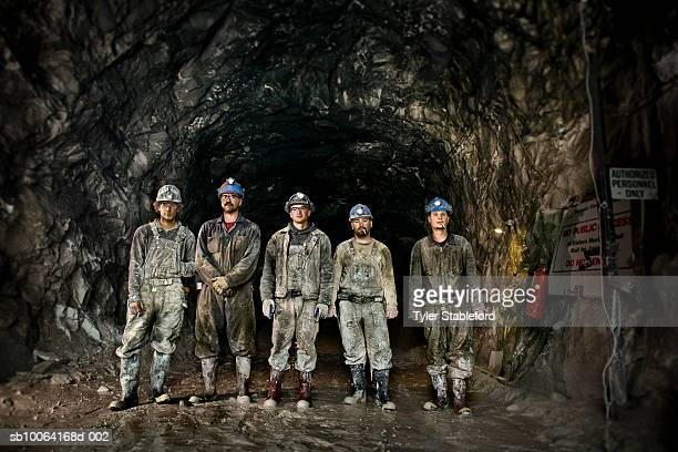 coal miners in front of mine shaft - coal mine stock pictures, royalty-free photos & images