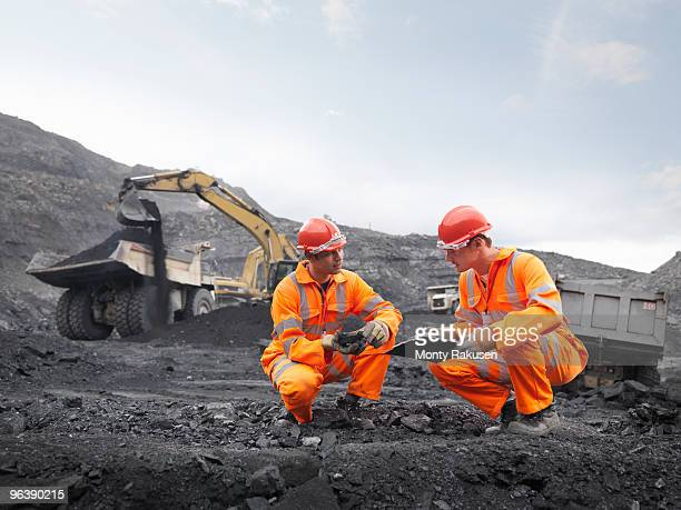 coal miners inspecting coal - mining equipment stock photos and pictures