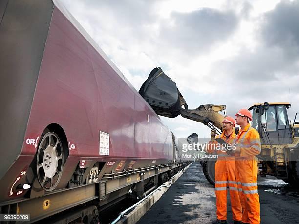 Coal Miners Inspecting Coal Train