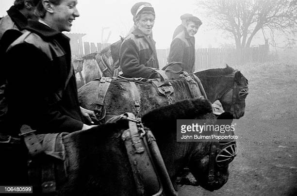 Coal miners leading pit ponies near Waldridge Colliery in County Durham circa 1963