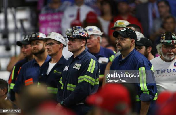Coal miners listen as President Donald Trump speaks at a rally on August 21 2018 in Charleston West Virginia Paul Manafort a former campaign manager...