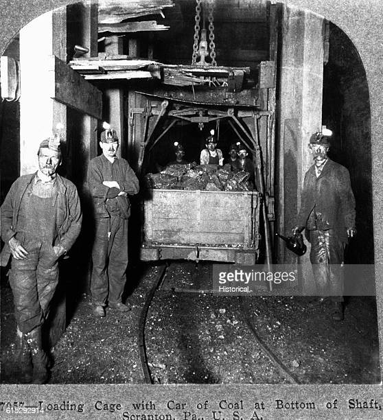 Coal miners load an elevator cage with a box car of coal to send to ground level three miles above the Pennsylvania mine Ca 1900
