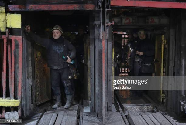 Coal miners prepare to descend in a highspeed elevator approximately 1000 meters below the surface at the KWK Pniowek coal mine on November 30 2018...