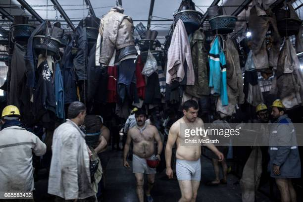 Coal miners prepare to wash and shower after finishing their shift underground at a large government run coal mine on April 4, 2017 in Zonguldak,...