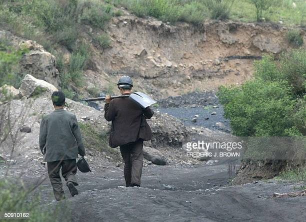 Coal miners set off to work in the hills outside of Xiaoyi city 26 May 2004 in rural Shanxi province China's biggest coalproducing province despite...