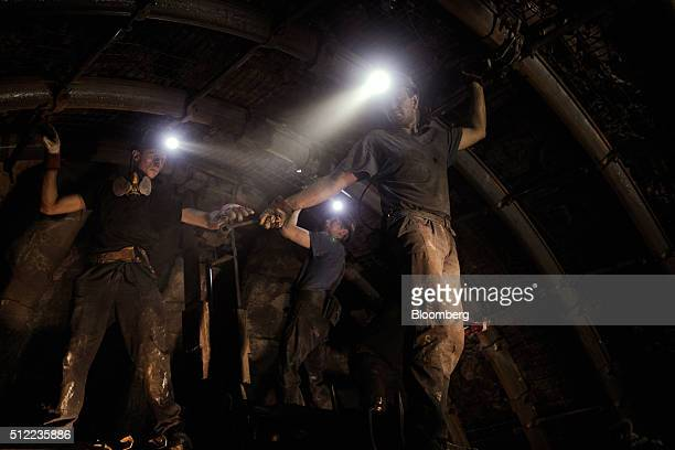 Coal miners shore up an underground tunnel near the cutting face in the Piniowek coal mine operated by Jastrzebska Spolka Weglowa SA in Pawlowice...
