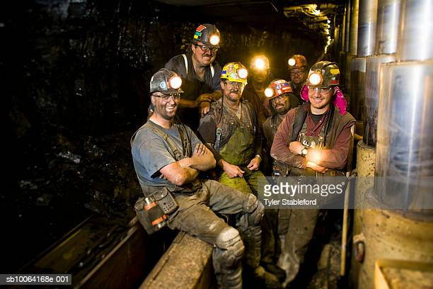 Coal miners smiling, portrait