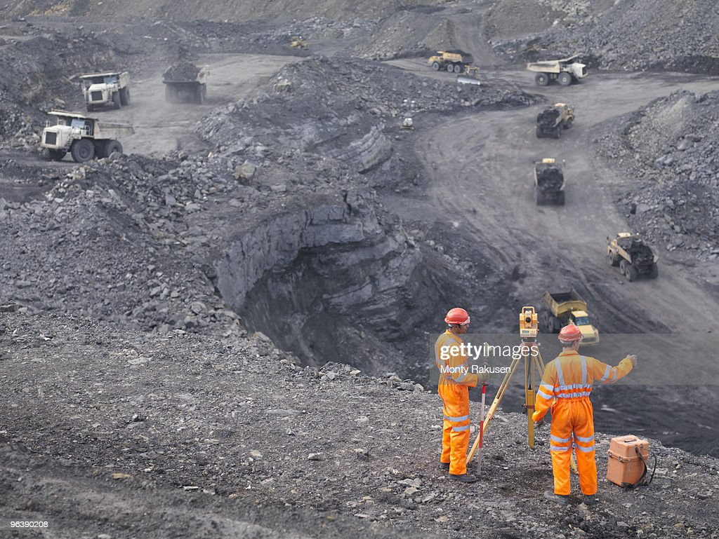 Coal Miners Surveying Mine From Above : Stock Photo