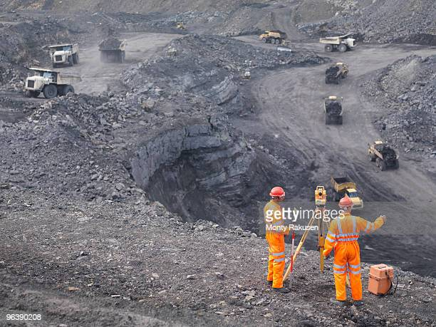 coal miners surveying mine from above - ancient civilisation stock pictures, royalty-free photos & images