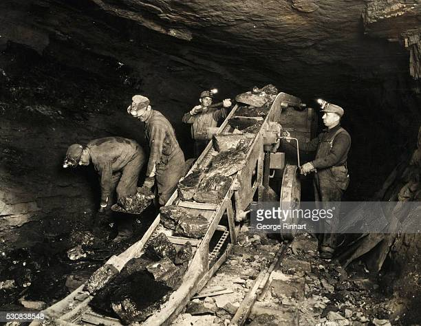 Coal Miners Using Automatic Conveyor