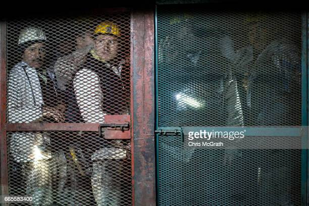 Coal miners wait in an elevator to take them back to the surface after finishing their shift at a large government run coal mine on April 4 2017 in...