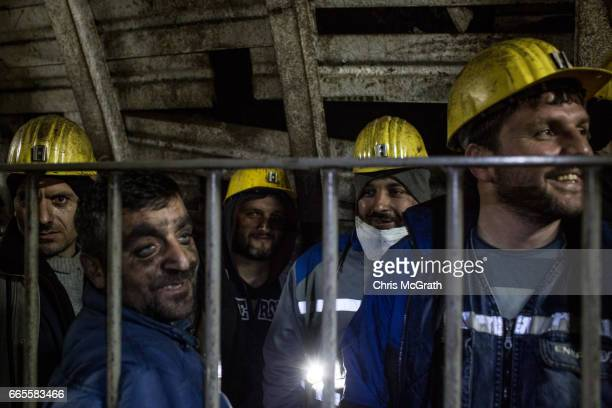 Coal miners wait to take the elevator back to the surface after finishing their shift at a large government run coal mine on April 4, 2017 in...