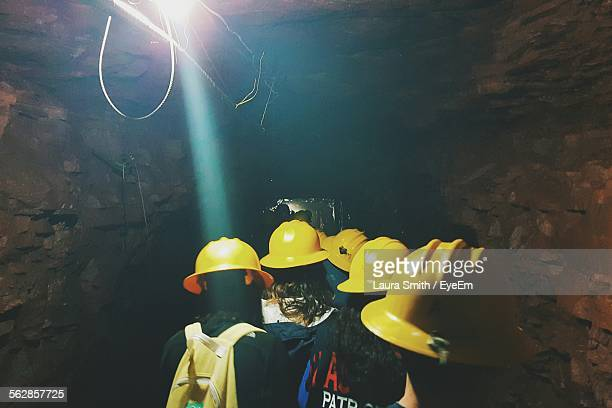 Coal Miners Walking In Cave