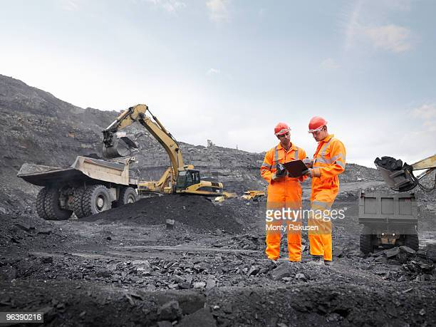 coal miners with clipboard - loader reading stock pictures, royalty-free photos & images