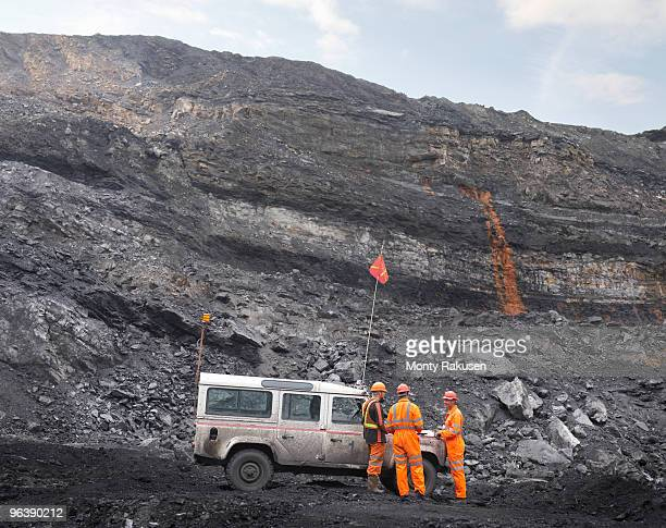 Coal Miners With Landrover In Mine