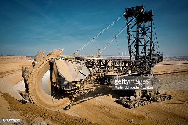 Coal Mining Machinery At Open-Pit Mine Against Sky