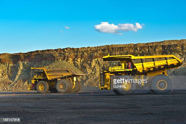 coal mining truck on haul road - coal mining stock photos and pictures