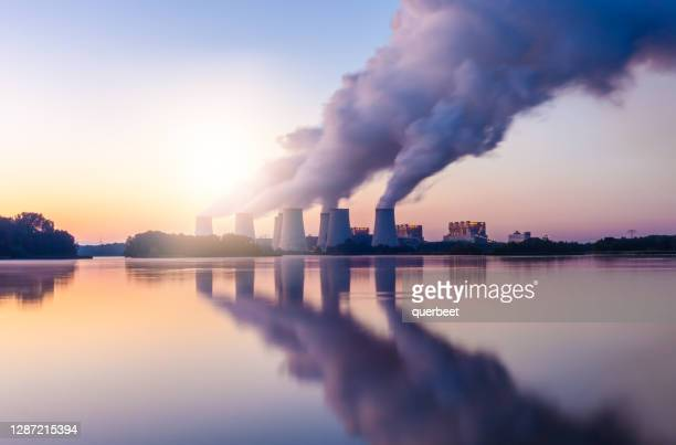 coal power plant at sunset - greenhouse gas stock pictures, royalty-free photos & images