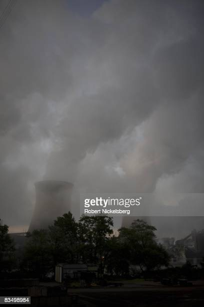 Coal smoke and steam vapor pour out of the Bruce Mansfield Power Plant overlooking an industrial area on September 11 2008 in Shippingport...