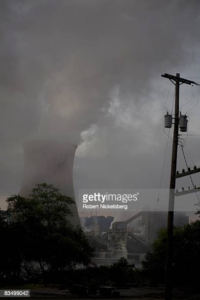 Coal smoke and steam vapor pour out of the Bruce Mansfield Power Plant at dawn overlooking an industrial area September 11 2008 in Shippingport...