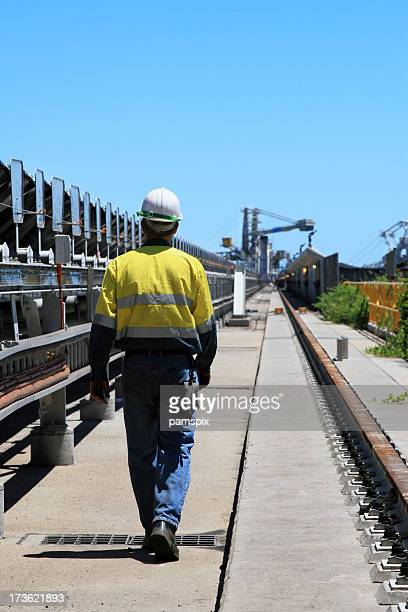 A coal terminal workman walking outdoors