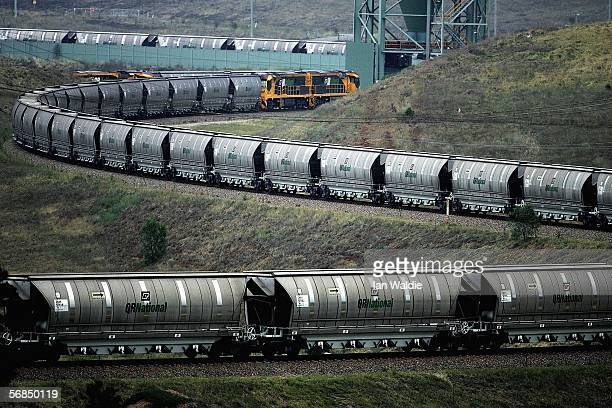 A coal train awaits loading at BHP Billiton's Mt Arthur coal mine February 15 2006 in Muswellbrook Australia BHP today posted the biggest interim...