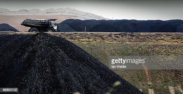 A coal truck passes a huge pile of coal at BHP Billiton's Mt Arthur coal mine February 15 2006 in Muswellbrook Australia BHP today posted the biggest...