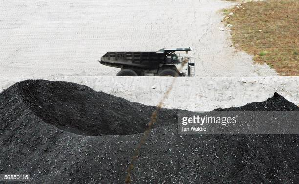 A coal truck passes a pile of coal at BHP Billiton's Mt Arthur coal mine February 15 2006 in Muswellbrook Australia BHP today posted the biggest...