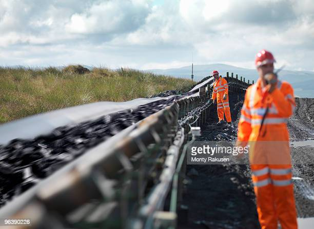 Coal Workers Inspecting Conveyor Belt
