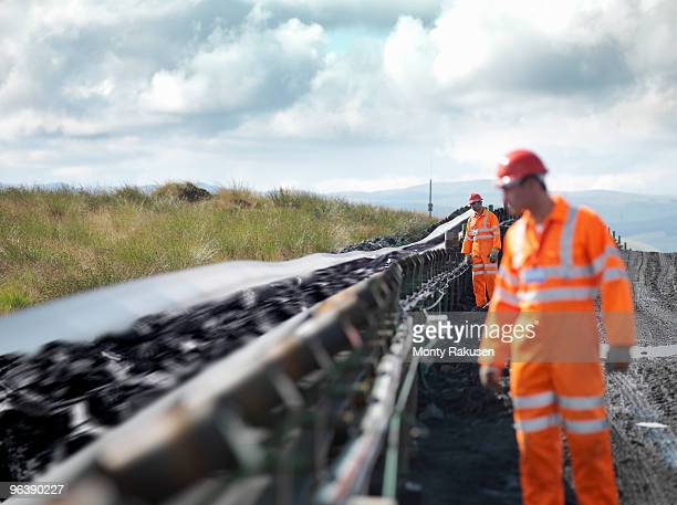 Coal Workers Inspecting Conveyor Belt