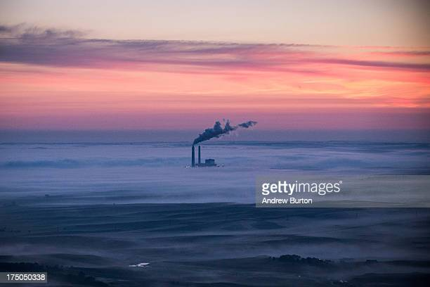 A coalburning energy plant is seen in an aerial view in the early morning hours of July 30 2013 near Bismarck North Dakota Gas flares are caused when...