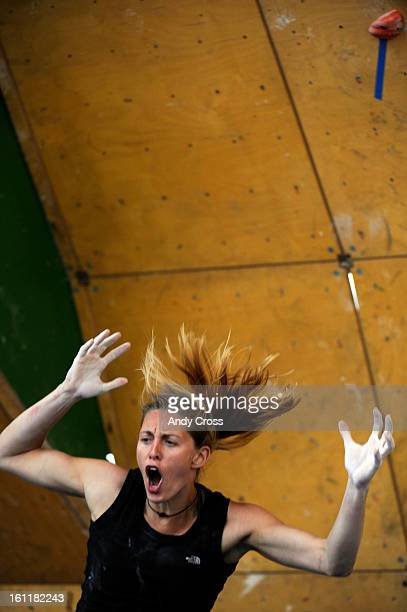 Alex Johnson, USA, reacts as she falls to the pads below after reaching the top of the climbing wall, but slipped off during an attempt, not scoring...