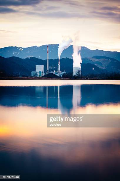 Coal-Fired Power Plant By The Lake At Evening Light
