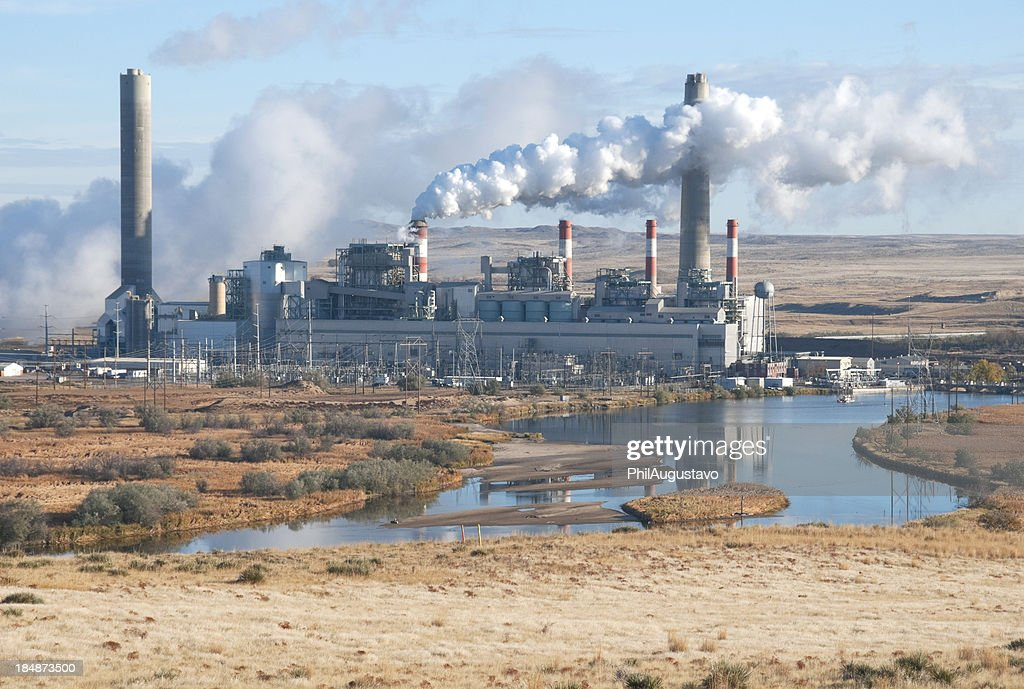 Coal-fired power plant on river in eastern Wyoming : Stock Photo