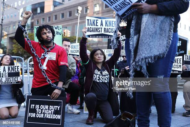 A coalition of advocacy groups 'take a knee' outside of a hotel where members the quarterly NFL league meetings are being held on October 17 2017 in...