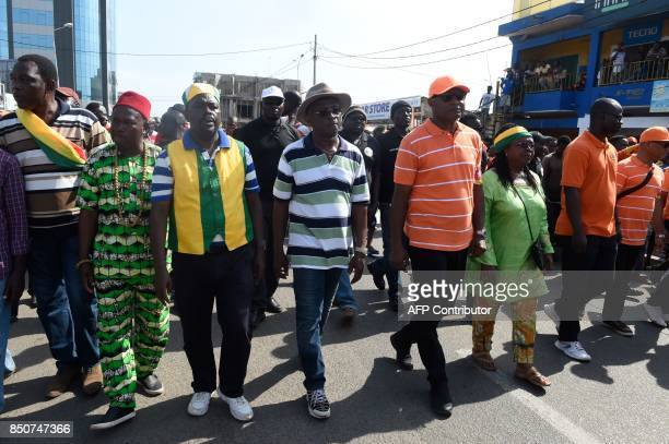 A coalition of opposition parties led by JeanPierre Fabre president of Togo's main opposition party the National Alliance for Change march during a...