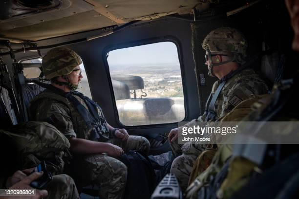 Coalition soldiers fly to Baghdad International Airport from the International Zone in a U.S. Blackhawk helicopter on May 31, 2021 in Baghdad, Iraq....
