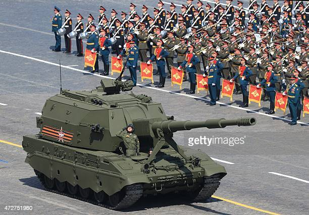 A CoalitionSV class selfpropelled howitzer drives through Red Square during the Victory Day military parade in Moscow on May 9 2015 Russian President...