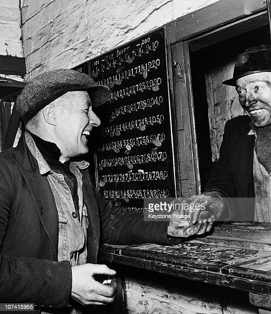 Coalmine Miner Handing In His Tally And Check At The End Of His Shift In Great Britain