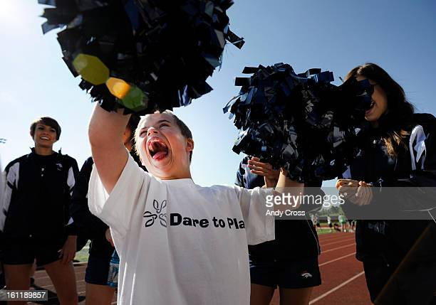 RANCH COAndrew Goodspeed 11yearsold with Down Syndrome tests his cheering abilities with poms in hand from the Denver Broncos cheerleaders out on the...