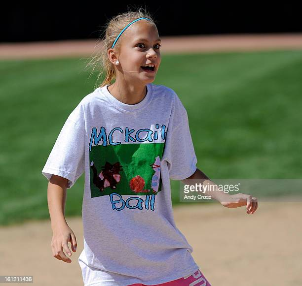 DENVER COAnna Murdy 10yearsold reacts after running safely to third base during the 3rd annual McKaila Ball a kickball party at the Colorado Rockies...