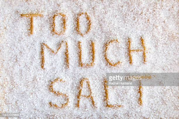 Coarse salt with the words 'too much salt'