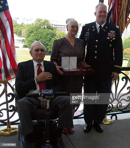 Coarsegold California residents Wes and Anna Heinrichs receive medals earned by Anna's first husband Roy John Spencer at a presentation of World War...