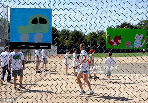 DENVER COArtwork by McKaila J Steffes was hung on the backstop fence for the 3rd annual McKaila Ball a kickball party at the Colorado Rockies...