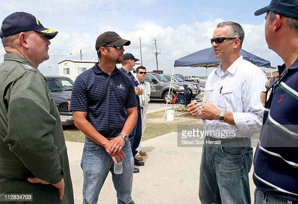 US Coast Guard Admiral Thad Allen national incident commander left talks to contractors Sean Short of ESH and Shawn Essert of Blue Group and Jerry...