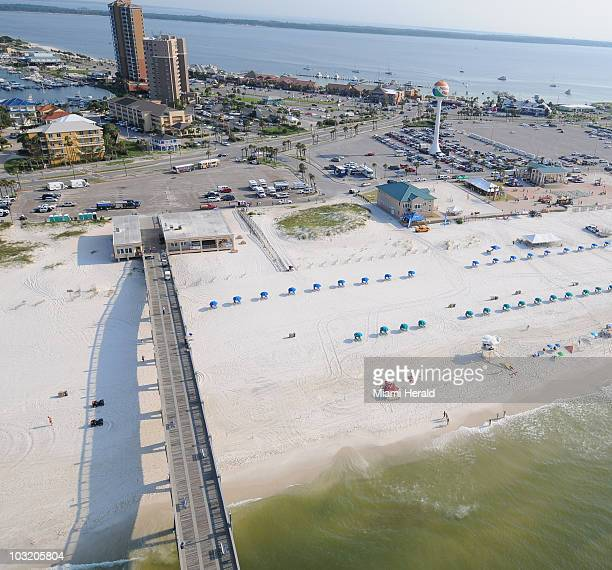 A Coast Guard air patrol shows the beaches and pier in Pensacola Florida are clear of tar balls and other oil debris from the Gulf spill on July 9...