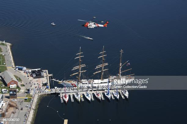 Coast Guard Air Station Cape Cod MH60 Jayhawk helicopter flying over Newport Volvo Ocean Race Rhode Island May 8 2018 Image courtesy Petty Officer...