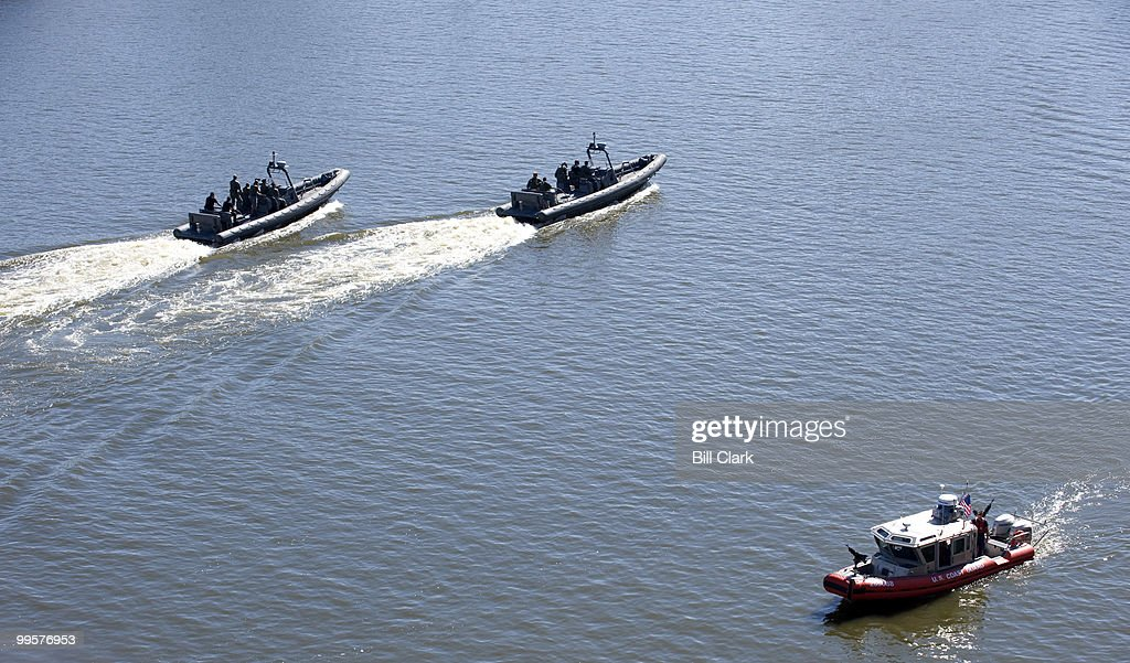 Coast Guard and military boats patrol the Mississippi River at the Republican National Convention in St. Paul, Minn., on Wednesday, Sept. 3, 2008.